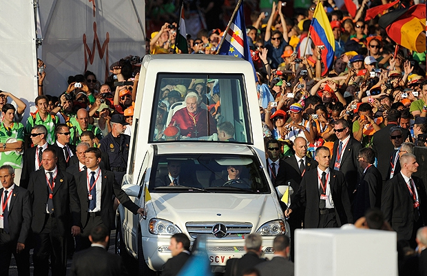 Pope Benedict XVI is surrounded by security guards in his pope mobile on arriving at Cibeles square during World Youth Day 2011 celebrations on August 18, 2011 in Madrid, Spain.