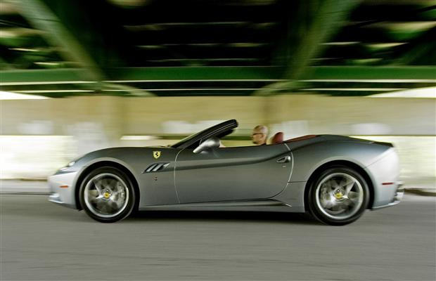 David Booth driving a Ferrari California.