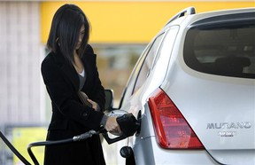 A woman fills her Nissan Murano with gas at a Toronto gas station.