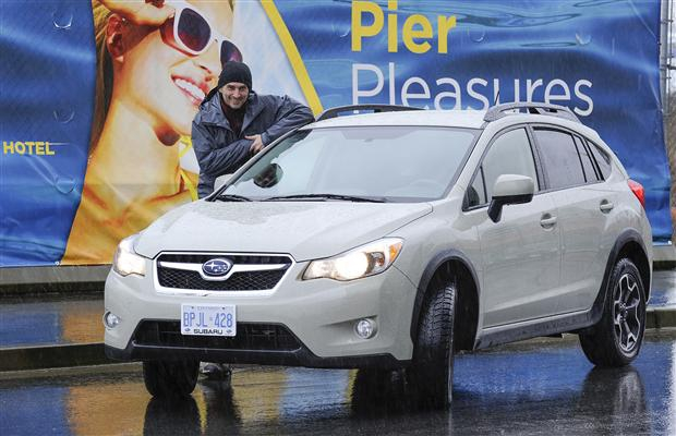 Mountain Film Festival director Alan Formanek and 2013 Subaru Outback in North Vancouver B.C.