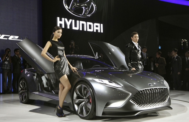 "South Korean models pose with a Hyundai Motors HND-9 Venace""during a press day of the Seoul Motor Show."