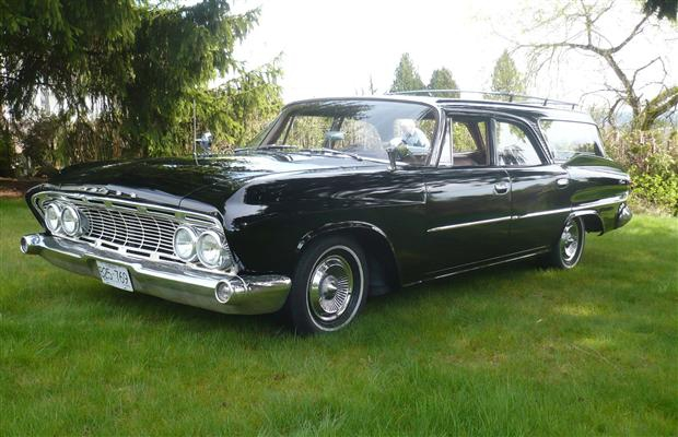 The black 1961 Dodge Dart Pioneer station wagon.