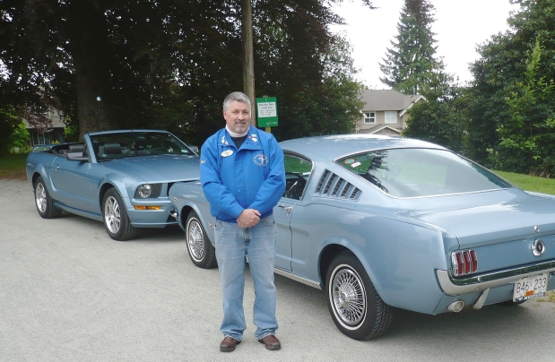 Pat Comey with his parents' original 1965 Mustang 2+2 Fastback and his 2005 Windveil Blue Mustang GT convertible. Alyn Edwards photos/special to the sun