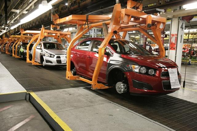 In this April 25, 2012 photo, Chevrolet Sonics move down the line in Orion Township, Mich. THE CANADIAN PRESS/AP, Duane Burleson