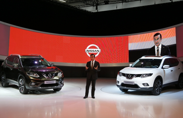 Nissan CEO Carlos Ghosn presents the new Nissan X-Trail during the first press day of the 65th Frankfurt Auto Show in Frankfurt.