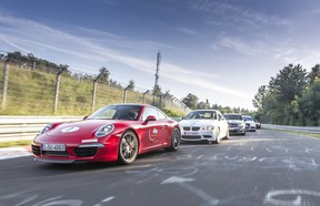 Cars drive the Nurburgring course, which is one of the most difficult in the world.
