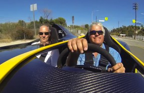 Jay Leno drives the ultra exclusive Aston Martin CC100 concept, and the look on his face says it all.