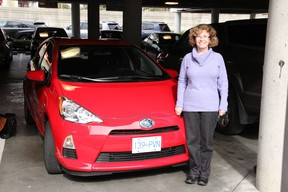 North Burnaby's Holly McManus with the Toyota Prius C she drove as part of the Commuting Challenge.