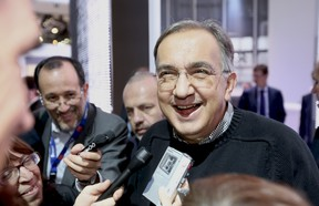 Sergio Marchionne, chief executive officer of Fiat SpA, reacts as he speaks to members of the media following a meeting of motor manufacturers at the Fiat SpA stand, on the second day of the Paris Motor Show in Paris, France, on Friday, Sept. 28, 2012.