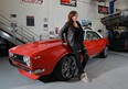 Nicole Rodriguez with her 1969 Camaro SS that she restored with the help of her brother and dad.