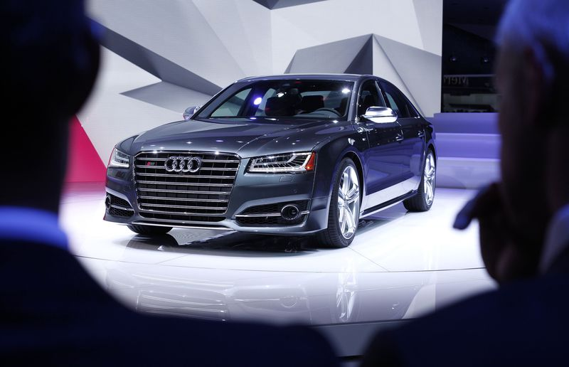 The new Audi S8 is revealed at the press preview of the 2014 North American International Auto Show January 13, 2014 in Detroit, Michigan.