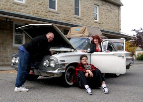 Steve Pasztor, his wife Deirdre and his son Kaeluis Bruce-Pasztor with their pooch Del Ray, named after a 1958 Chevrolet, with their 1960 Chevrolet Nomad at the Alberta Ballet building.