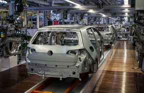 Bare metal chassis of seventh-generation Golfs move slowly down the line. Production is underway, but still in a testing mode.