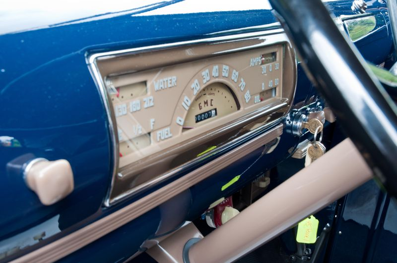 The beautifully restored dashboard and interior of the 1945 GMC panel delivery truck.