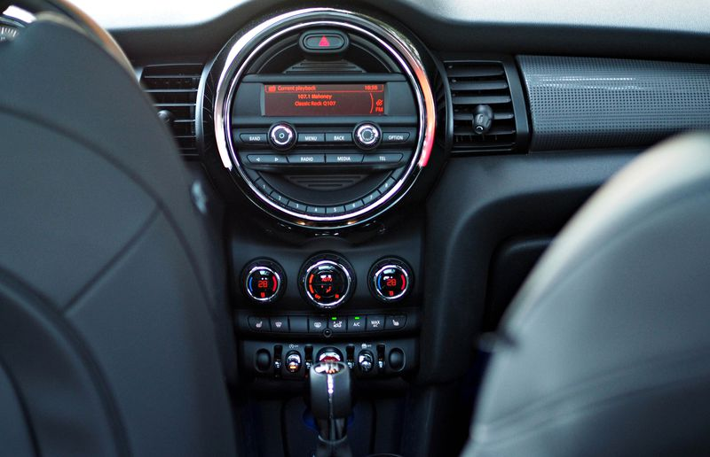 A glowing light circles the huge centre dash entertainment LCD. The ring glows in proportion to how fast you're spinning the engine.