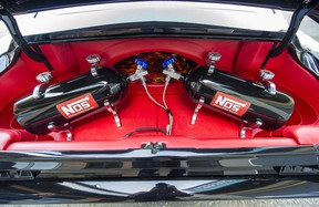 Two NOS tanks inside the trunk of a custom 1967 Mustang Fastback.