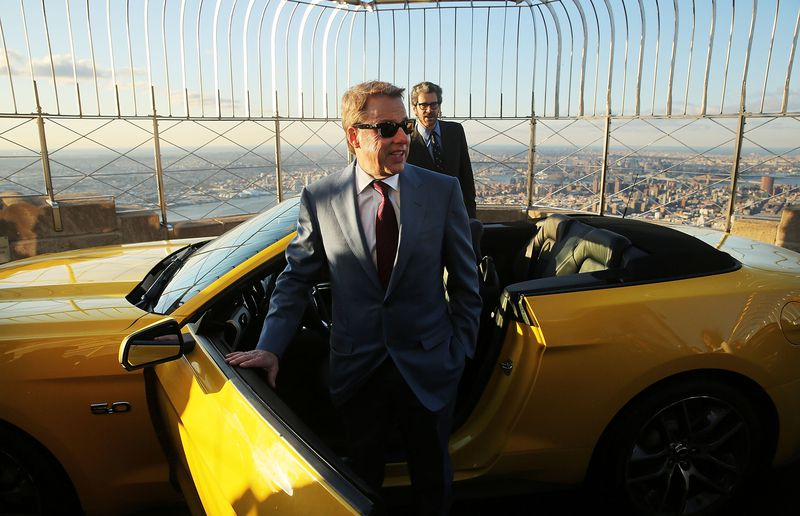 Ford executive chairman Bill Ford stands on top of the observation deck at the Empire State Building with the new 2015 Mustang convertible.