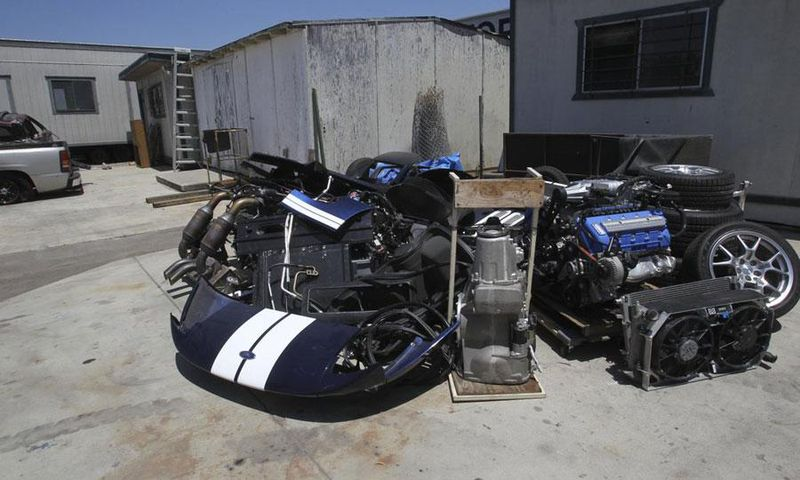 This stolen Ford GT was broken up for parts and unceremoniously dumped. Many parts couldn't be re-sold do to unique casting numbers