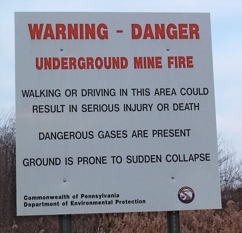 A sign warns drivers of unstable ground and toxic gases ahead in Centralia, Pennsylvania.