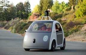 """Chris Urmson, head of Google's self-driving car initiative, sees """"real people"""" driving the company's autonomous vehicles on public roads in as early as two years."""
