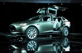 Tesla has announced deliveries of its upcoming Model X crossover have been postponed until 2015.
