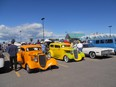 Hot rods under blue skies at Calgary fundraising show.