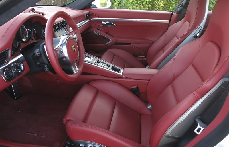 Described by Jeremy Clarkson as a capsule of speed, the 911s cabin is an exceptionally exciting place to be, especially when its dressed in flaming red leather.