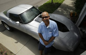George Talley, 71, poses with his 1979 Chevrolet Corvette in Detroit, Tuesday, July 1, 2014. Talley had believed the sports car was long gone after he parked it in Detroit in 1981 and it was stolen. On June 13, 2014 he received a  phone call from auto insurer AAA telling him his car was at a police station in Mississippi, about 840 miles southwest of Detroit.