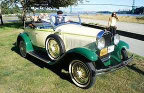 Lawrence Harrop with his three whippet friends and their favourite ride: a 1929 Whippet roadster.
