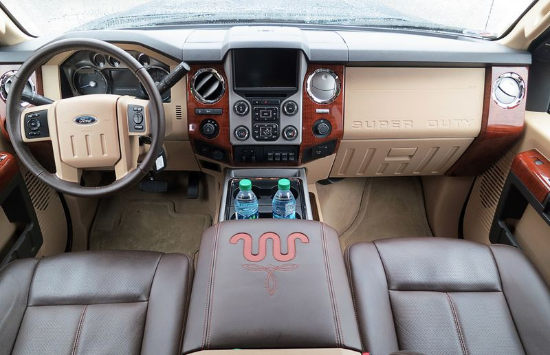 The interior of Ford's new Super Duty F-Series trucks has all the creature comforts. From slab-bottomed chairs and the ottoman-sized centre console upholstered in thick cowhide, the interior is a very nice place to be.