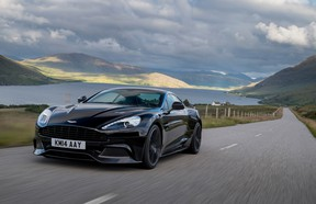 The 2015 Aston Martin Vanquish Coupe navigates the twisty sea-side roads in Inverness, Scotland.