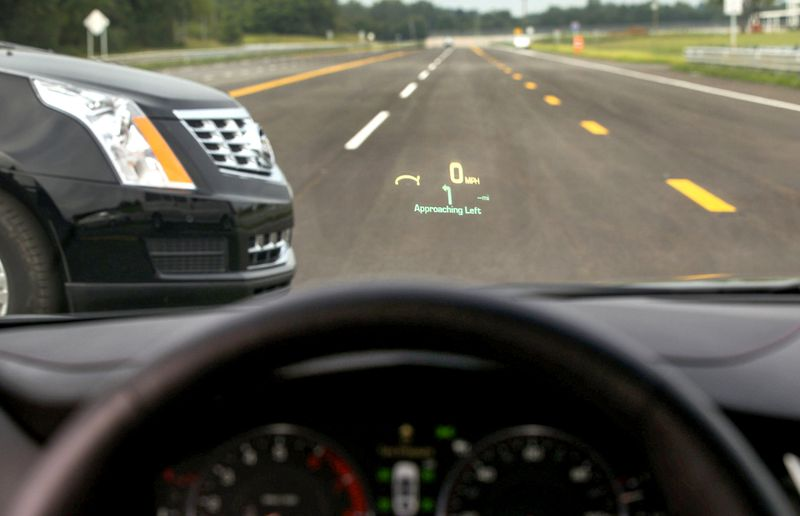 """GM's V2V communication enables cars to """"talk"""" to each other by sending and receivng basic information, such as speed and direction of travel as they approach."""