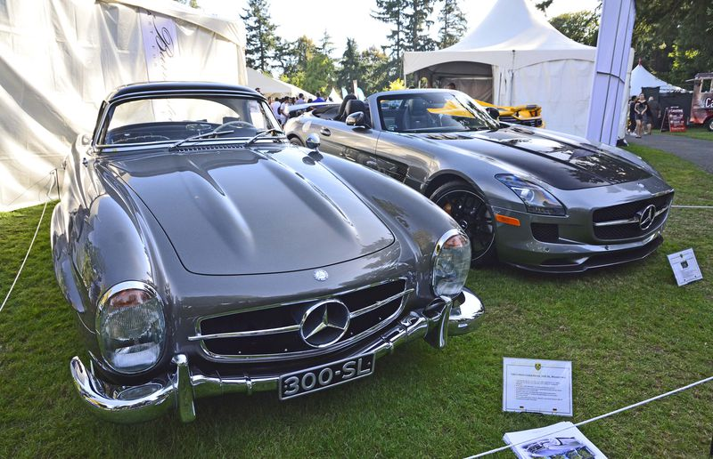 The classic Mercedes 300SL roadster and the modern Mercedes Supercar.