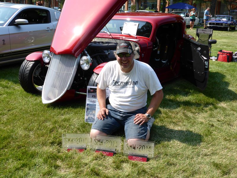 """Matthew Puzey in front of his car at Street Machine Weekend 2014 in Lethbridge where he achieved a triple victory with his 1933 Ford. The car won """"Fan Favorite"""" at the 100-foot dash where it also qualified for the Quick Street Final, """"Top 5 Ford"""" in the car show and """"Best Engineered Vehicle"""" of Street Machine Weekend."""