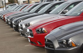 In this file photo, a line of unsold Chargers sits at a Dodge dealership in Colorado.