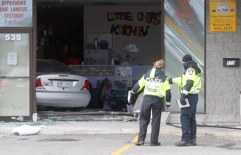 Police and firefighters at the scene of an accident where a car drove into a daycare at 535 St. Martin West in Laval, North of Montreal, Tuesday November 12, 2013.