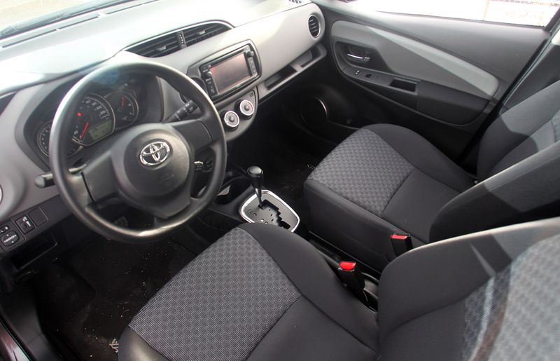 The interior of the 2015 Toyota Yaris LE.