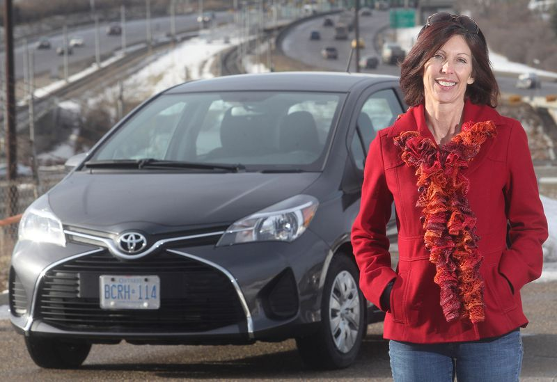Alanna Landymore and the 2015 Toyota Yaris LE she drove for five days in and around Calgary.