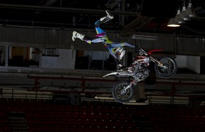 FMX rider Billy Kohut looks like he's hanging on for life, but is just performing another trick. He's part of the Extreme Thrills show at the Calgary Motorcycle Show.