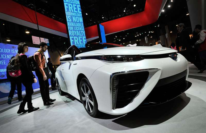 Attendees looks at the Toyota Mirai fuel-cell automobile while it is displayed at the Toyota booth at the 2015 International CES at the Las Vegas Convention Center on January 6, 2015 in Las Vegas, Nevada. CES, the world's largest annual consumer technology trade show, runs through January 9.