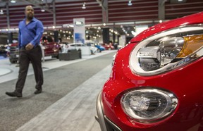 A man browses the FIAT section the 2015 International Auto and Truck Show at the BMO Centre in Calgary, on March 10, 2015.