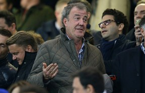 TV host Jeremy Clarkson gestures as he takes his place in the stands before the Champions League round of 16 second leg soccer match between Chelsea and Paris Saint Germain at Stamford Bridge stadium in London, Wednesday, March 11, 2015.