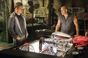 Paul Walker, left, and Vin Diesel, are shown in a scene from Fast & Furious 7.