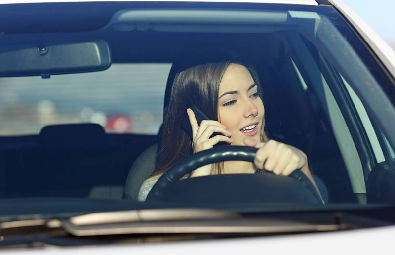 A woman talks on her phone while driving. A recent Texas study found women were 63 per cent more likely to talk on the phone while they were driving.