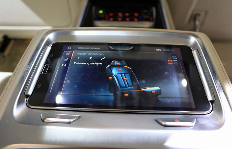 A removable seven-inch Android tablet sits in the rear armrest — part of the Executive Lounge option.