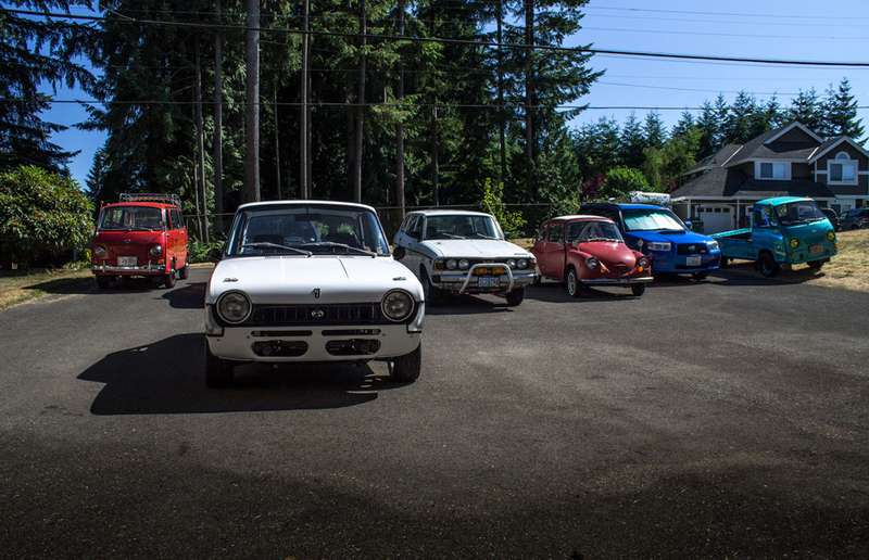 Jamie Cavett's current collection of old (and new) Subarus.