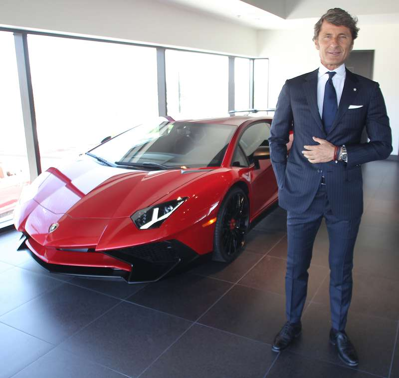 Lamborghini President and CEO Stephan Winkelmann poses beside an Aventador Superveloce Thursday, July 2, 2015, at the opening of the company's new dealership in Calgary.