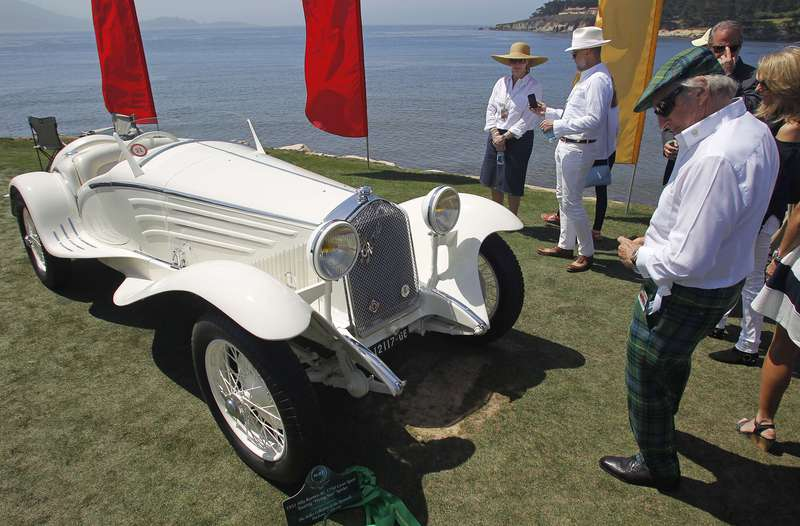 """Racing legend Jackie Stewart looks at a 1931 Alfa Romeo 6C 1750 Gran Sport Touring """"Flying Star"""" Spider during the Concours d'Elegance on August 16, 2015 in Pebble Beach, California. The annual charitable event, which was founded in 1950, is billed as the world's top-ranked collector car competition. Entrants are judged for their style, technical precision and historical authenticity. AFP PHOTO/Michael FIALAMICHAEL FIALA/AFP/Getty Images"""
