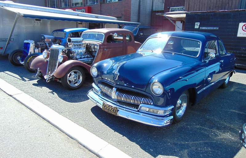 1949 Meteor coupe and two 1934 Ford hot rods displayed by Luke Balogh.