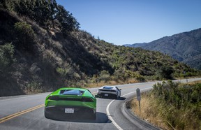 Supercars race through the hills of Monterey.